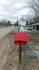 A beloved Snoopy mailbox was returned to a woman the same day it went missing.