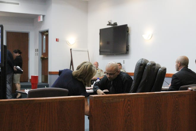 Matias Loza, one of two men accused of being involved in the murder of Richard Valdez in 2011, confers with his legal counsel.