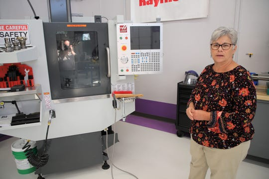 Judy Castleberry, director of San Juan College's Enterprise Center, shows off some of the high-tech equipment at The Big Idea @ SJC Aug. 22 after the school recently received a federal grant for the facility.