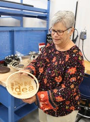 San Juan College Enterprise Center Director Judy Castleberry displays a wooden bowl created with a laser cutter at The Big Idea @ SJC.
