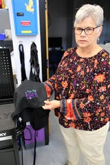 Judy Castleberry, director of the San Juan College Enterprise Center, displays an embroidery project completed using sewing equipment at The Big Idea @ SJC.