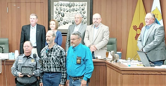 Lincoln County Deputy  Russ Wehnau, front left, was recognized for saving the life of Neil McCombs, center.  At right front is Sheriff Robert Shepperd. In back from left are county commissioners Tom Stewart, Elaine Allen, Lynn Willard, Dallas Draper and Chairman Preston Stone.