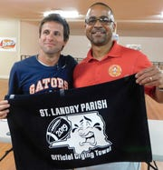 Sal Diesi III, interim head football coach at Beau Chene, holds up the crying towel he won on Tuesday night during the annual St. Landry Parish Football Jamboree meeting in Opelousas. Presenting the towel to Diesi is parish athletic director Jerome Robinson.