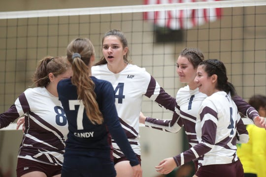 La Quinta High School varsity volleyball players react during the game at Coachella Valley High School in Thermal, Calif., on Wednesday, August 21, 2019. La Quinta won.