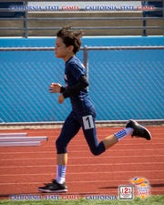Jonathan Figueira-Schieldge is on his way to a first place finish in the boys 8 and under 1500 meters. He was a gold medalist in the 800 and 1500 at the California State championship and was crowned the California State Champ in both events.