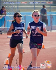 Julie Inda, left  and Emily Feffer compete in the 1500 meter finals in California State championship in La Jolla.
