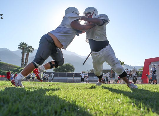 The Palm Springs High School football team practices for the upcoming season in Palm Springs, August 21, 2019.