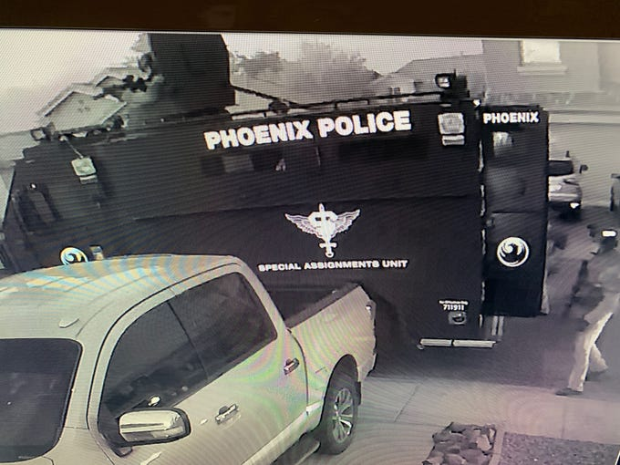 Surveillance video from the Abdulaziz family home in west Phoenix shows the Phoenix Police Department Special Assignments Unit responded to the home June 10.