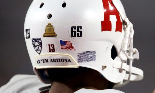 The Wildcats honored the USS Arizona on the 75th anniversary of its sinking in 2016. The gray jerseys were meant to mimic the color of the ship, while the simplified block A on the helmet was taken from photos of the ship's sports teams.