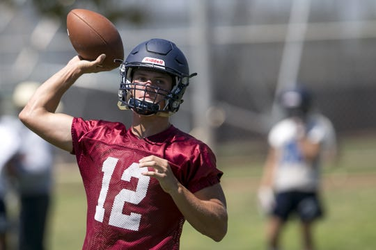 Perry quarterback Chubba Purdy (12) practices with his team at Perry High School in Gilbert, Ariz. on Aug 21, 2019.