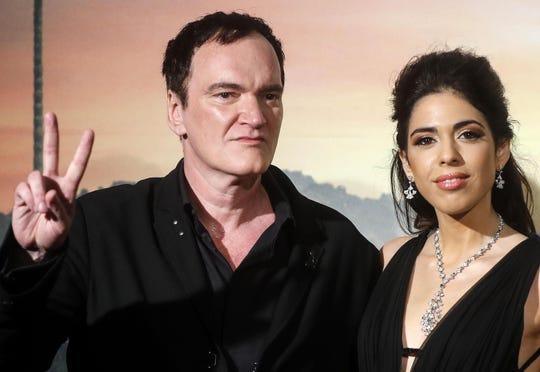 Quentin Tarantino (izq) junto a su esposa Daniela Pick.