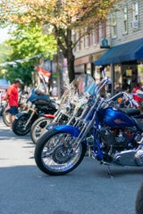 Some of the many cars and motorcycles at Sunday's event on cumberland Street.