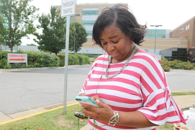 Judy Johnson, of Sandusky, checks out the new Firelands Virtual Care app, which allows users to visit a Firelands doctor right through their own phone from anywhere.