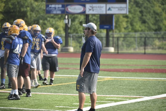 New Waynesboro head coach Josh Sprenkle overlooks his team at practice.