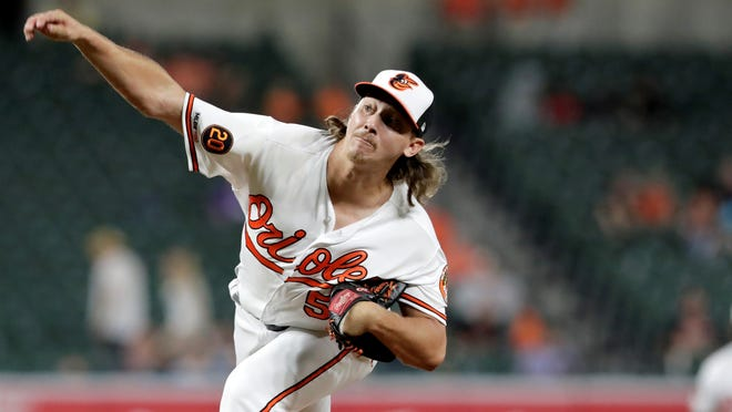 Baltimore Orioles relief pitcher Hunter Harvey throws a pitch to a Kansas City Royals batter during the eighth inning of a baseball game, Tuesday, Aug. 20, 2019, in Baltimore. The Orioles won 4-1. (AP Photo/Julio Cortez)