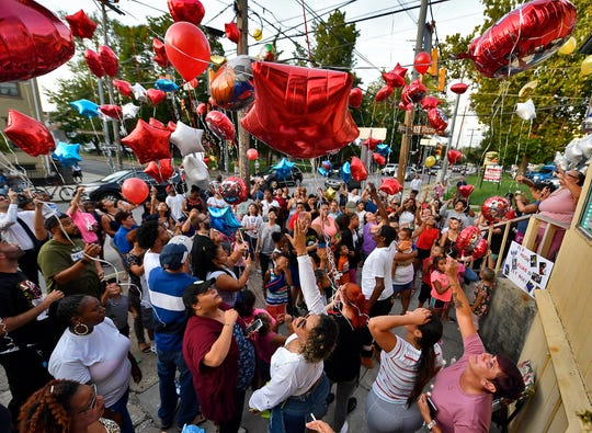 Family and friends hold a balloon release at the corner of East Philadelphia Street and North Pine Street for Elias Dowlatram, the five-year-old boy who died from an accidental shooting, Tuesday, August 20.