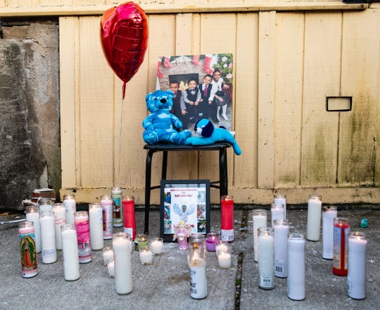 A memorial for Elias Dowlatram sits at the end of East Philadelphia street in front of the Royal Court Barber Lounge in York.