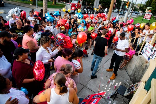 In this photo from Aug. 21, 2019, people gather to release balloons in memory of Elias Dowlatram, 5, of York.