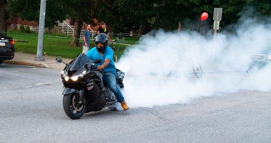 Motorcycles performed burnouts to show their respect for Elias Dowlatram.