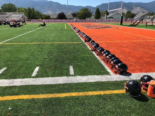 Helmets sit on the new football field surface at Douglas.