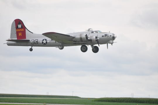 The B-17 bomber named Aluminum Overcast takes off Thursday from Richmond Municipal Airport.