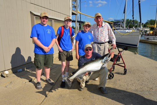 Lou Langie, far right, and members of Troop 37 Boy Scouts of America, Seneca Waterways Council. Langie is founder of Casting for Character Sport Fishing Tournament, which supports myriad Scouting programs. This year's event raised more than $100,000 and involved more than 170 anglers from numerous businesses in the Rochester region.