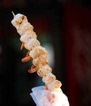 Grilled shrimp on a stick for sale at the Great New York State Fair on Wednesday, Aug. 21, 2019.