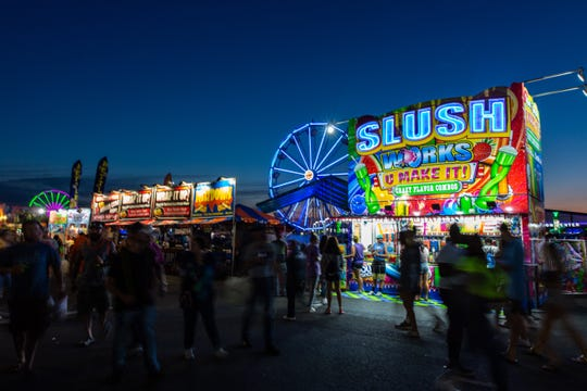 Crowds wander through the Great New York State Fair as the first day comes to a close on Wednesday, Aug. 21, 2019.