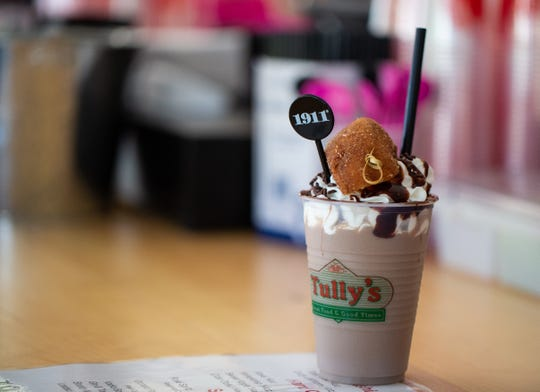 The Tipsy Cow: Made with Byrne Dairy chocolate milk,Cold Brew Coffee Vodka and cold brew coffee from Syracuse-based Recess Coffee. It's topped with whipped cream, chocolate sprinkles and half a donut.