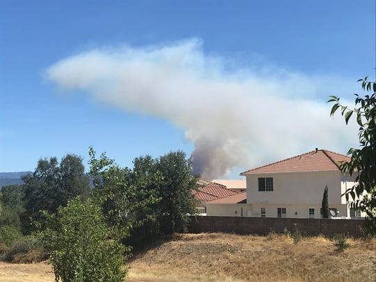 The plume of smoke from a fire in Jones Valley can be seen from Redding.
