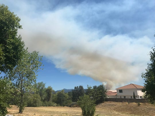 A large plume of smoke from the fire in Jones Valley could be seen from Redding on Thursday morning.