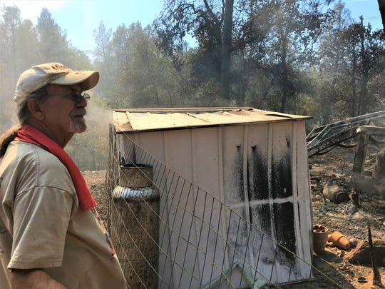 Steven Griffith surveys were the Mountain Fire destroyed buildings on his property on Thursday.