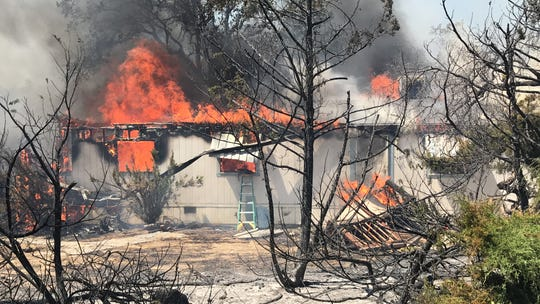 A home off Bear Mountain Road is engulfed in flames on Thursday, Aug. 22, 2019. The Mountain Fire in the Jones Valley is threatening 1,100 structures.