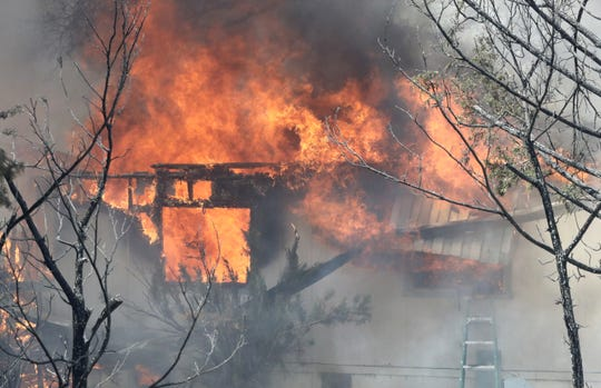 The Mountain Fire burns a home off Bear Mountain Road in Jones Valley northeast of Redding on Thursday, Aug. 22, 2019.