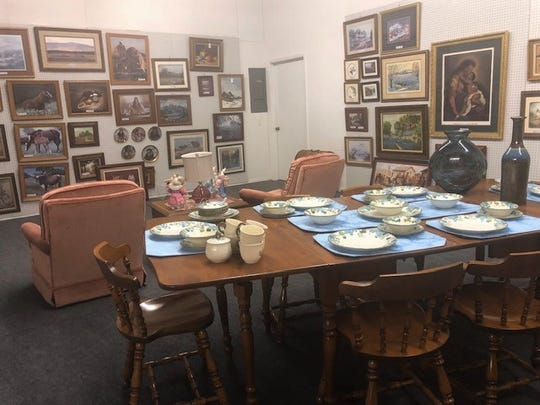 In one of the back rooms at Madison's Avenue, there is lots of antiques, furniture and paintings.