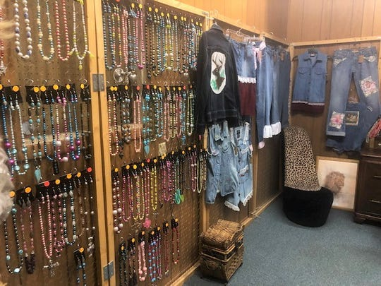 Owner at Madison's Avenue, Linda Massengill, creates jewelry and custom denim clothing pieces for the store.