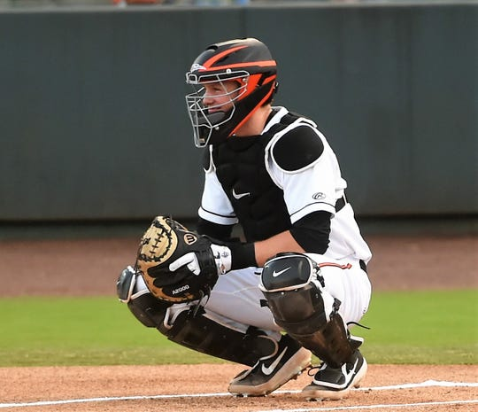 Baltimore Orioles' No. 1 overall pick Adley Rutschman sets up shop behind home plate during his Delmarva Shorebirds' debut on Wednesday, Aug. 21, 2019.