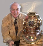 Richard Bennett pictured with a historic diving helmet.