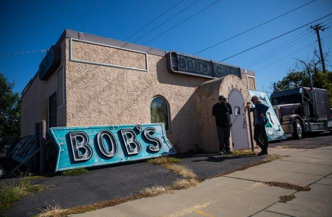 The iconic Bob's Cafe sign on West 12th Street is taken down to be sold on Thursday, Aug. 22.