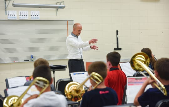 Jon Hegg teaches sixth grade band at Lennox High School on Thursday, August 22.