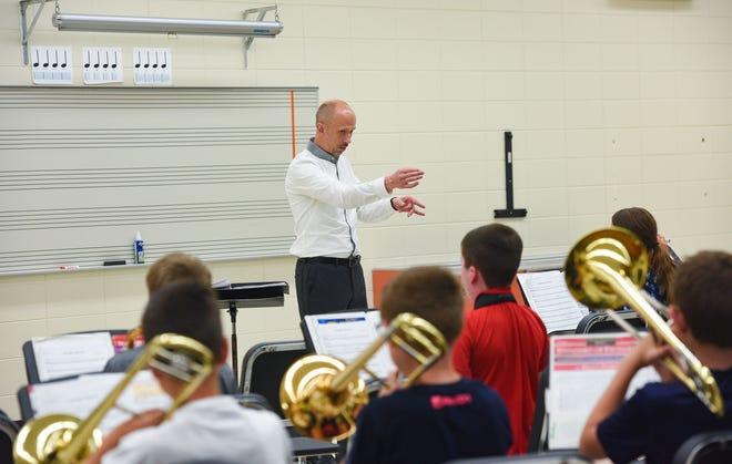 Jon Hegg teaches sixth grade band at Lennox High School on Thursday, August 22.