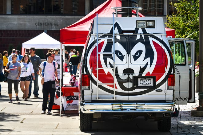 Students look through displays by campus groups and activities near Atwood Memorial Center during move in day Thursday, Aug. 22, at St. Cloud State University.