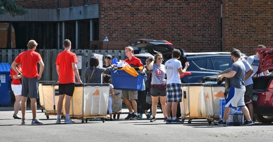 Students get some assistance from Husky Helpers while moving belongings into Sherburne Hall Thursday, Aug. 22, 2019, at St. Cloud State University.