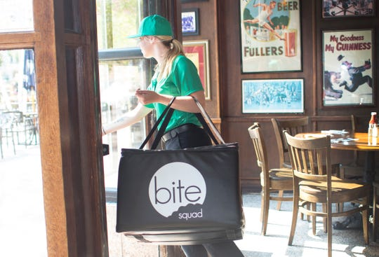 A Bite Squad driver heads out for a delivery. Bite Squad's arrival in St. Cloud will create about 100 jobs, according to the company.