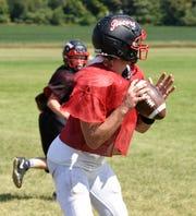 Senior quarterback Jack Steil looks for receivers Thursday, Aug. 22, 2019, at ROCORI High School.