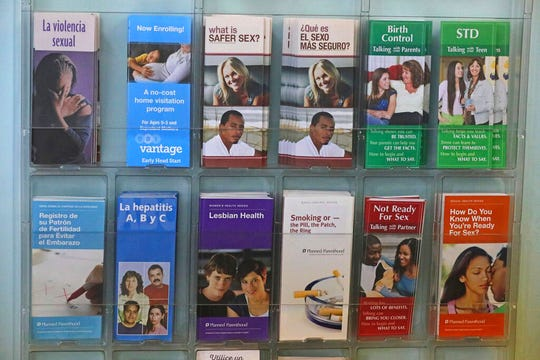 Pamphlets are shown in the clinic of Planned Parenthood of Utah Wednesday, Aug. 21, 2019, in Salt Lake City. About 39,000 people received treatment from Planned Parenthood of Utah in 2018 under a federal family planning program called Title X. The organization this week announced it is pulling out of the program rather than abide by a new Trump administration rule prohibiting clinics from referring women for abortions. (AP Photo/Rick Bowmer)