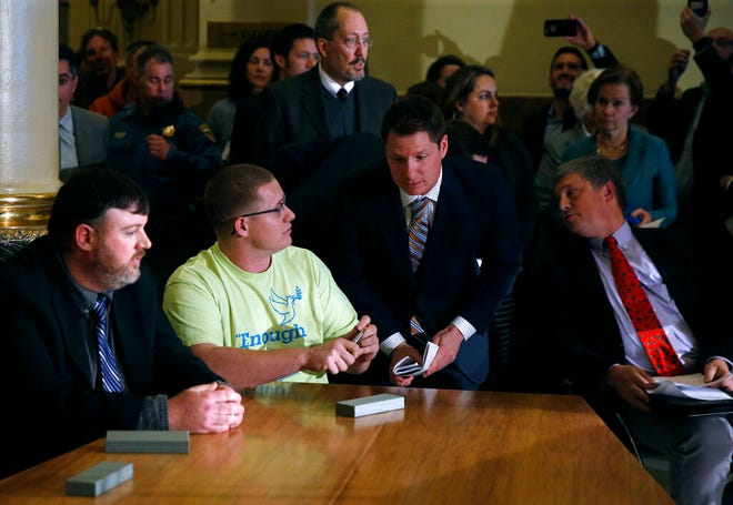 In this Dec. 19, 2016, file photo, Colorado elector Micheal Baca, second from left, talks with legal counsel after he was removed from the panel for voting for a different candidate than the one who won the popular vote, during the Electoral College vote at the Capitol in Denver. Colorado Secretary of State Wayne Williams, front right, looks on. On Tuesday, Aug. 20, 2019, the 10th U.S. Circuit Court of Appeals ruled that Williams violated the Constitution when he removed Baca from the panel.