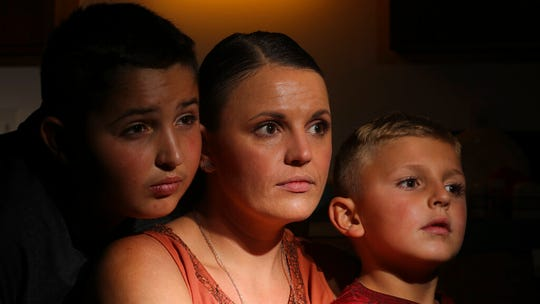 Misty Dotson poses for a photograph with her son's at their home Tuesday, Aug. 20, 2019, in Murray, Utah.