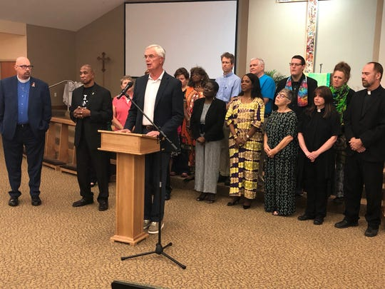 Michael Butler and faith leaders at recent Restorative Justice Press Conference.