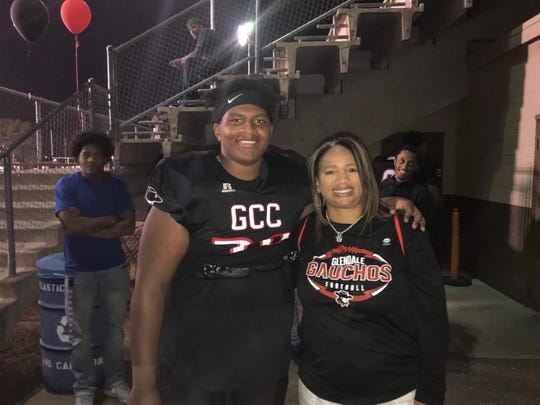 Jalen Spady stands with him mother Barbara Spady after a game with the Glendale Community College Gauchos. He is now playing guard at FAMU.